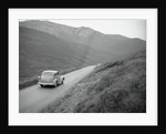 Car Traveling in the Highlands by Corbis