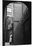 Man Outside Ye Olde Mitre Tavern by Corbis