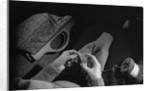 Girl Knitting by Corbis