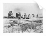 Combine Harvesters at Work in Canada by Corbis