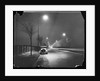 Car on a Lit Road by Corbis