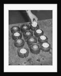 Golf Balls in Molds by Corbis