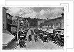 Horse-Drawn Carriages and Storefronts on Mackinac Island by Corbis