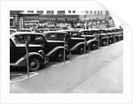 Cars Parked on Street by Corbis