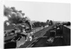 Engine Moving Through a Rail Yard by Corbis