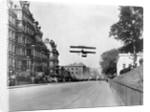 Biplane Flying Over Washington by Corbis
