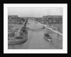 Boat on Aldebaran Canal Passing Houses in Venice, California by Corbis
