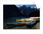 Canoes at Moraine Lake in Banff by Corbis