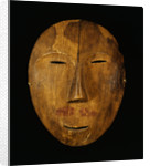 An Eskimo Wood Face Mask from Northern Alaska by Corbis