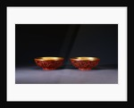 A Pair of Carved Red Lacquer Dragon Bowls by Corbis