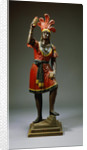 A Carved and Painted Pine Cigar-Store Indian. American, Late 19th Century by Corbis