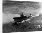 A Japanese cruiser (Katori Class) sinking off the coast of French Indo-China after attack by SB2c's from the USS Hancock. January 12, 1945 by Corbis