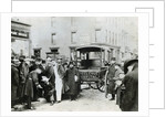 Ambulance Idling by Crowd by Corbis