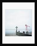 Woman Balancing on a Breakwater by Corbis