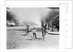 Family Riding Bikes by Corbis
