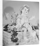A Doll Sitting on a Wall by Corbis