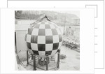 Checkered Steel Sphere Resting on Platform by Corbis