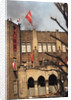Student Waving Flag from Top of Building by Corbis