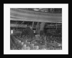 Inspector Viewing Ruins of Theater by Corbis
