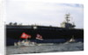 Ship and Boats with Flag Carriers Against the Nuclear Vessel by Corbis