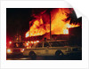 Burning Buildings with Police on the Scene by Corbis