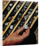 Container of Mineral Deposits Being Examined by Corbis