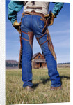 Cowboy Outside Homestead by Corbis