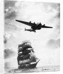 Airplane Flying over Ship by Corbis