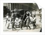 Children Dancing Around Organ Grinder by Corbis