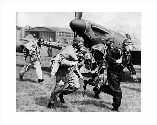 Fighter pilots run to their planes by Associated Newspapers