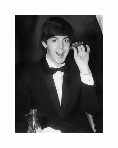Paul McCartney with a cigar by Associated Newspapers