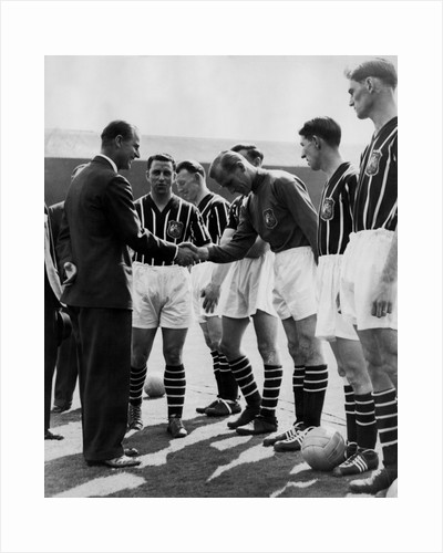 Prince Philip meeting members of Manchester City team by Associated Newspapers