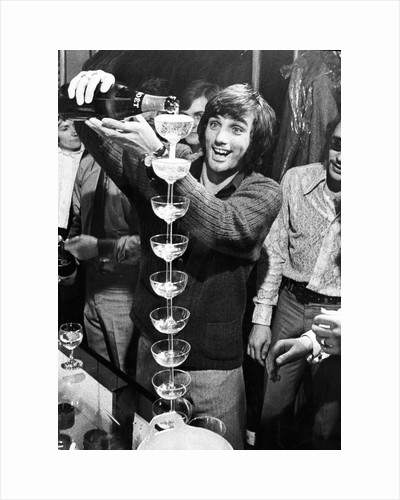George Best, footballer pouring champagne by Associated Newspapers