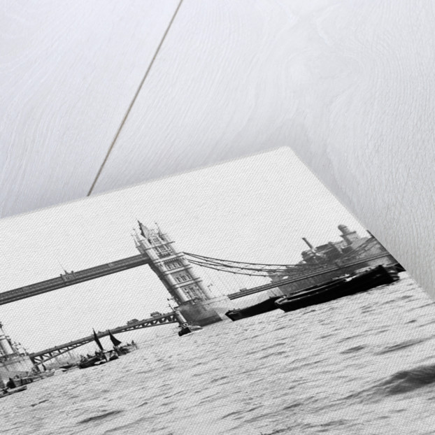 Tower Bridge with bascules closed and barges passing under at high water, London by Anonymous