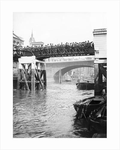 Passengers for the river bus service on the footbridge to London Bridge Pier, London by Barbant