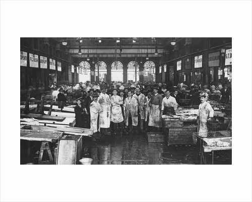 The interior of Billingsgate Market showing fishmongers and their stalls, London by Anonymous