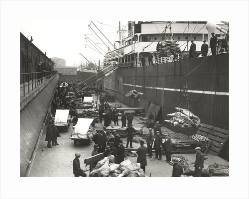 Cargo being loaded or unloaded from a ship, Royal Victoria Dock, Canning Town, London by Anonymous