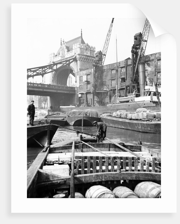 Lighters approaching the General Steam Navigation Company's wharf by Tower Bridge, London by