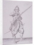 Figure in military clothing holding a musket and wearing a sword by