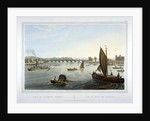 Water craft on the River Thames with Vauxhall Bridge in the distance, London by