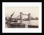 View of Tower Bridge under construction with river traffic in the foreground, London by Anonymous