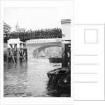 Passengers for the river bus service on the footbridge to London Bridge Pier, London by