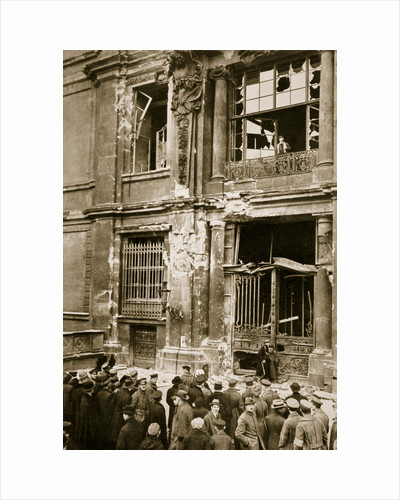 A crowd of men gathered in front of a ruined building, Germany by Unknown