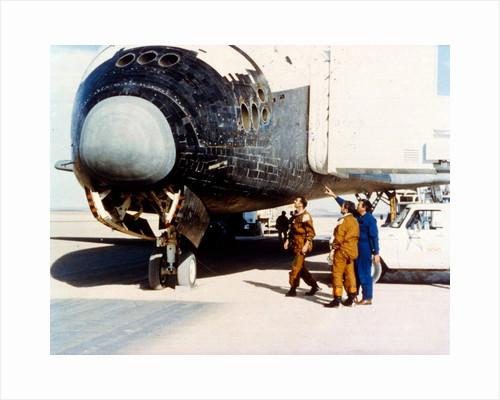 Inspecting heat tiles, second Space Shuttle flight, November 1981 by NASA