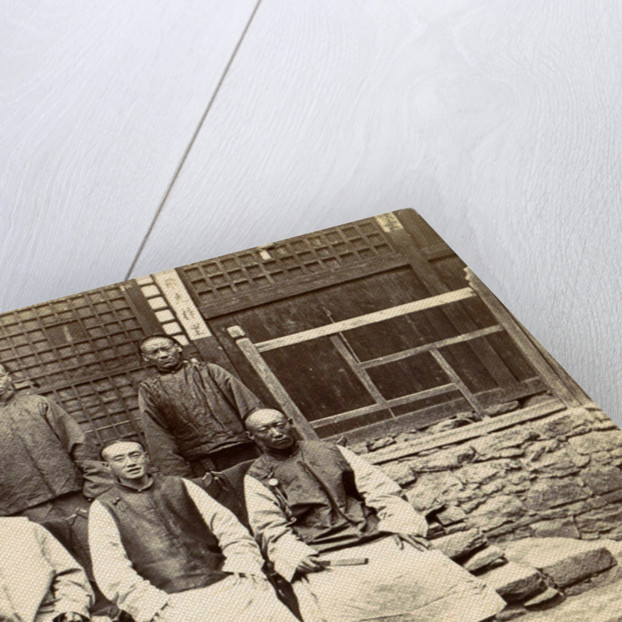 Chinese men and a boy near a house in Tibet by D.T. Dalton