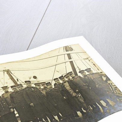 Group portrait of crew on deck of a ship by Anonymous