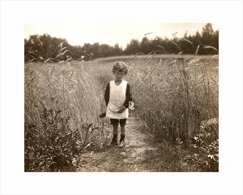 Eckart Titzenthaler, son of the photographer, standing in a field by Waldemar Titzenthaler