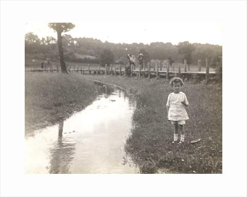 Eckart Titzenthaler, son of the photographer, standing beside a stream by Waldemar Titzenthaler
