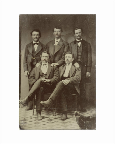 Group portrait of five men, standing and sitting in a studio (right two feet of another person) by Anonymous