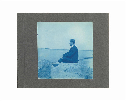 Man in profile, sitting on a rock by the sea, United States, Cyanotype, a photographic printing process that produces a cyan-blue print by Anonymous